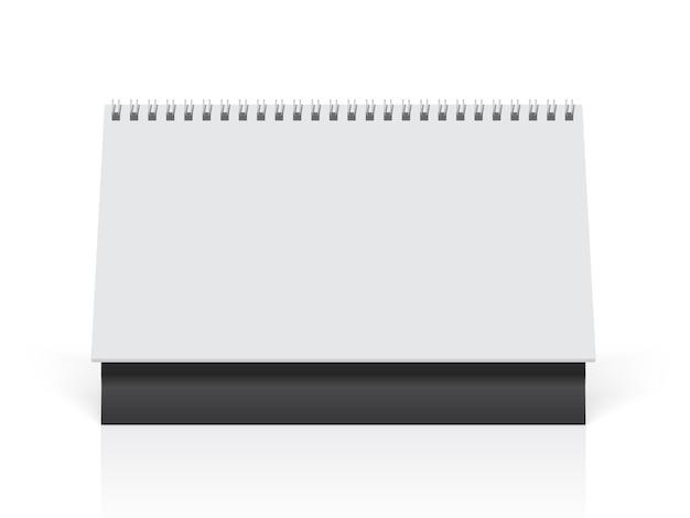 Calendário de papel branco está em cima da mesa