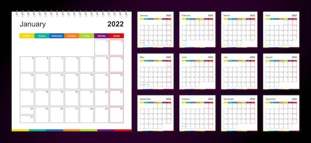 Calendário de parede colorido para 2022 em fundo escuro, a semana começa na segunda-feira.