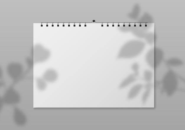 Calendário de parede em branco. vista frontal do planejador quadrado vazio com páginas de papel branco e sombra da planta. evento de data, diário do mês, modelo de calendário. maquete de vetor