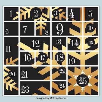 Calendário do advento com flocos de neve dourados