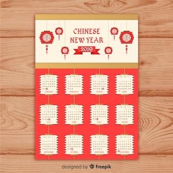 Calendário do ano novo chinês vermelho e dourado