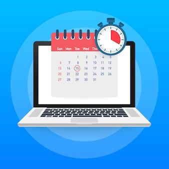 Calendário e relógio na tela do laptop.