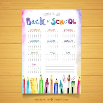 Calendário escolar aquarela com materiais