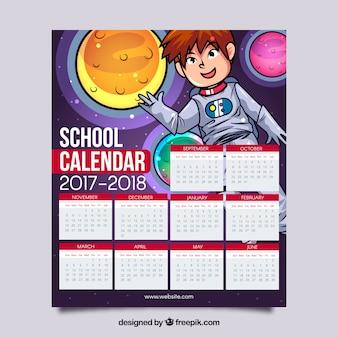 Calendário escolar com astronauta e planetas desenhados a mão