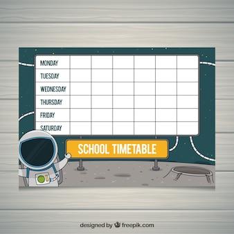 Calendário escolar com astronauta