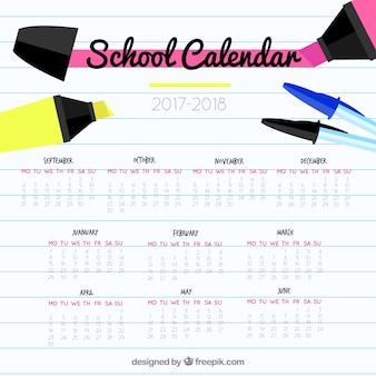 Calendário escolar com canetas