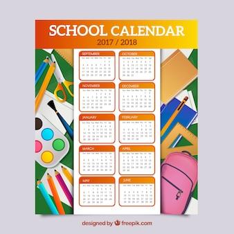 Calendário escolar com elementos em design plano