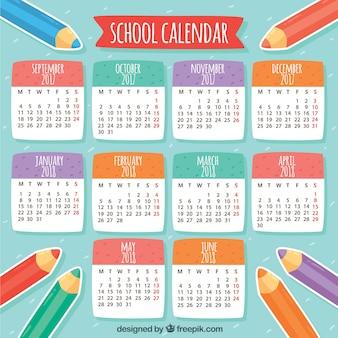 Calendário escolar com lápis de cor