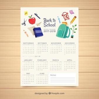 Calendário escolar com materiais aquarela