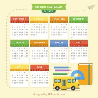 Calendário escolar com ônibus escolar e materiais