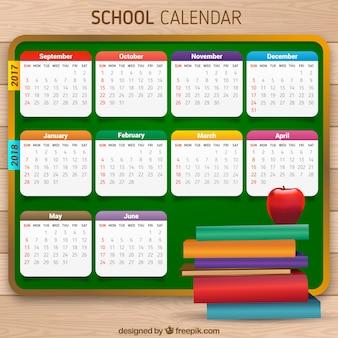Calendário escolar do quadro-negro com livros e maçã