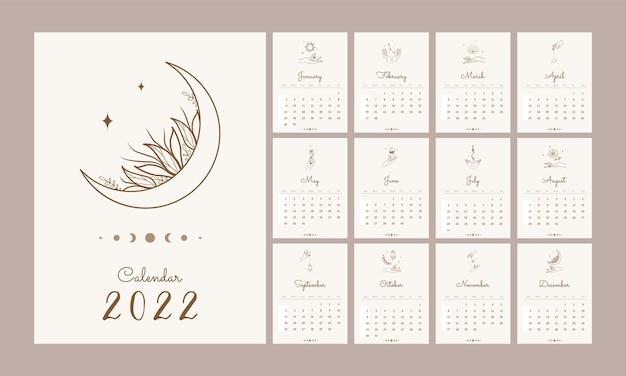 Calendário mágico de 2022. modelo com as mãos e elementos celestes.