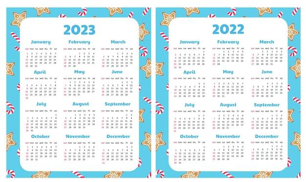 Calendários para 2022 e 2023 com fundo de natal. biscoito de gengibre e pirulito.