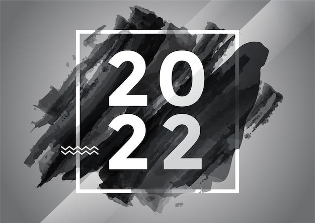 Caligrafia de letras em aquarela de pincelada escura com fundo de feliz ano novo de 2022