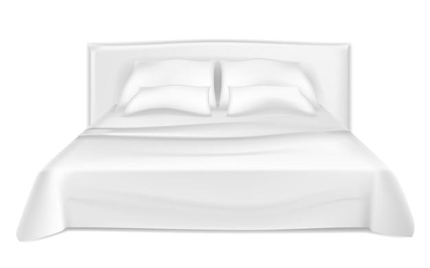 Cama branca vazia e travesseiros.