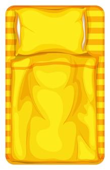 Cama com manta amarela e travesseiro