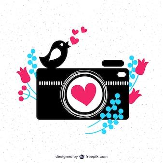 Câmera bonito e um pássaro