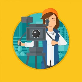 Camerawoman com a câmera de filme no tripé.
