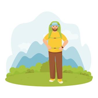 Caminhadas um homem com uma mochila grande em um fundo de montanhas.