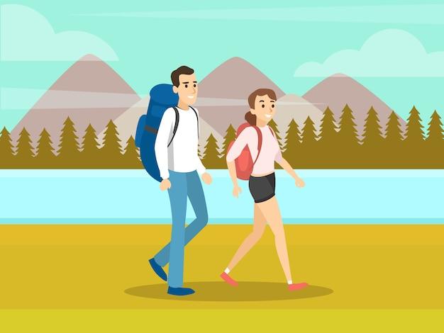 Caminhando turistas andando sobre um fundo de montanhas.