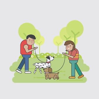 Caminhantes do cão que encontram-se no parque