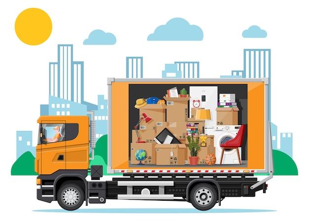 Caminhão de entrega cheio de coisas para casa dentro. mudança para uma nova casa