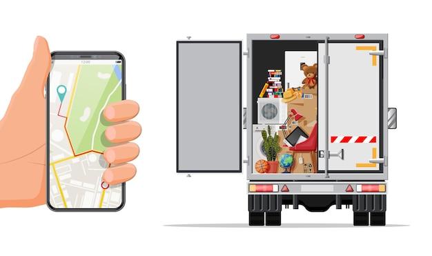 Caminhão de entrega com utensílios domésticos, smartphone com mapa. mudança para uma nova casa