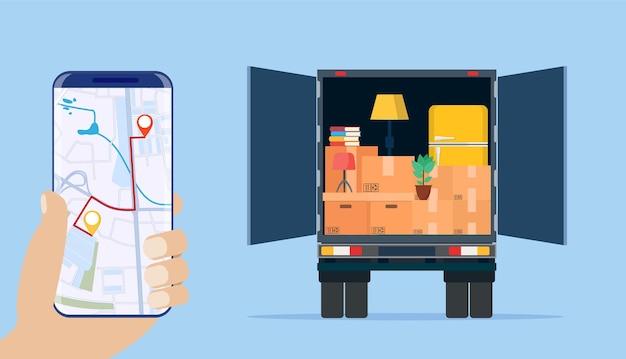 Caminhão de entrega com utensílios domésticos, smartphone com mapa.