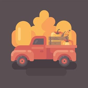 Caminhão de fazenda velha com abóboras com árvores amarelas no fundo