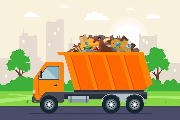 Caminhão de lixo laranja vai para o lixão na estrada.