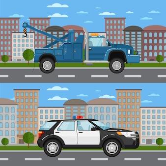 Caminhão de reboque e carro de polícia na paisagem urbana