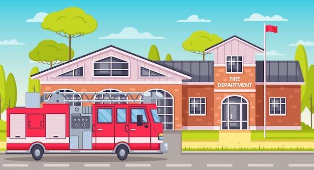 Caminhão do bombeiro estacionado em frente ao corpo de bombeiros.