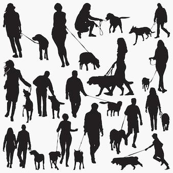 Caminhe com silhuetas de cães