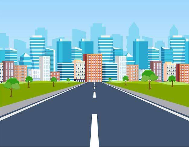 Caminho da estrada para os edifícios da cidade no horizonte.