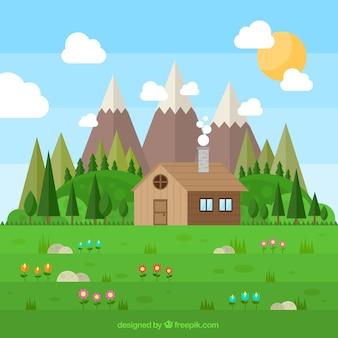 Campo bonito com uma cabana de madeira