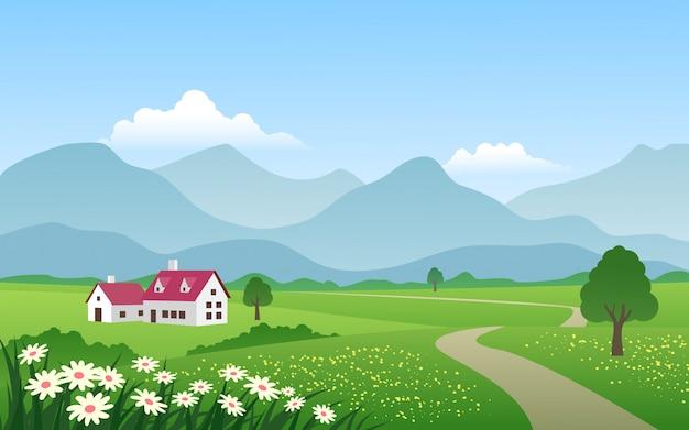 Campo com campo verde perto da montanha