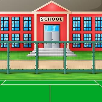 Campo de esporte em frente ao prédio da escola