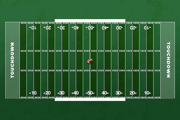 Campo de futebol americano e bola de rugby no meio