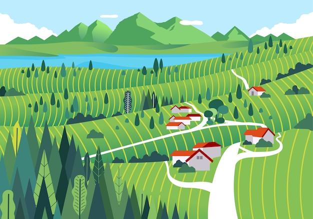 Campo nas montanhas com casas, lago, floresta e vastos campos verdes