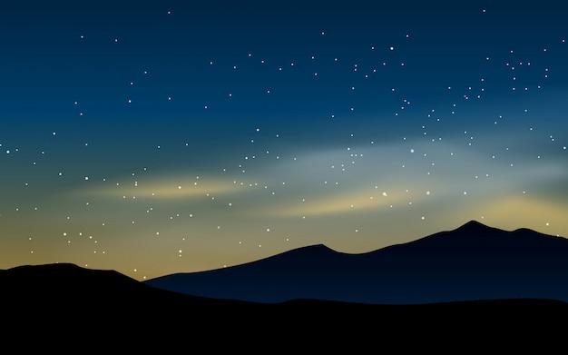 Campo vazio na noite estrelada com montanha