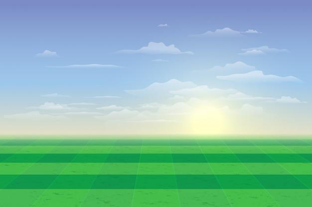 Campo verde com fundo azul do céu e nuvens