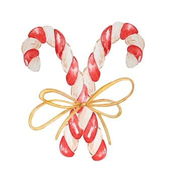 Cana-de-doces de natal em aquarela. dois doces pintados à mão, pirulito listrado amarrado com um laço, isolado