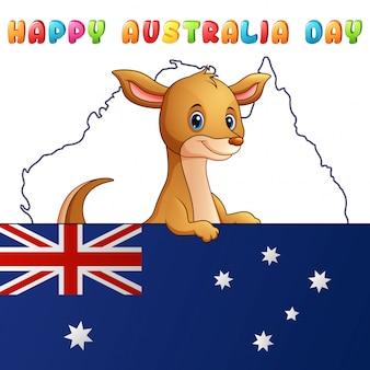 Canguru bonito dos desenhos animados atrás de uma bandeira no fundo do mapa