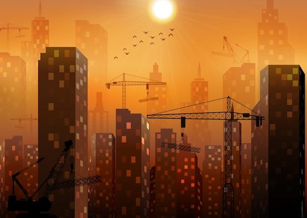 Canteiro de obras com edifícios e guindastes
