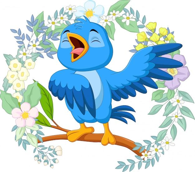 Canto de pássaro azul dos desenhos animados no galho de árvore
