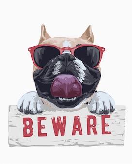 Cão bonito em óculos de sol segurando beware sinal