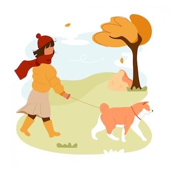 Cão de passeio menina na trela no parque.