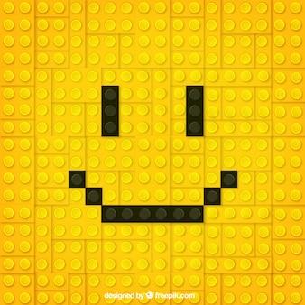 Cara sorridente amarela de fundo de pedaços