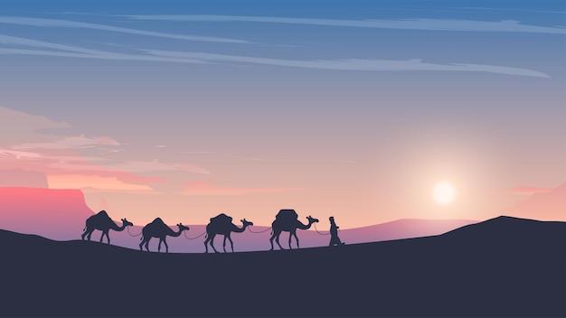 Caravana de camelos ao pôr do sol no deserto árabe