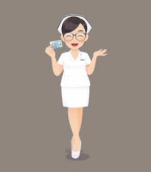 Caricatura, mulher, doutor enfermeira, óculos marrom, em, uniforme branco, segurando, cartão id, sorrindo, femininas, equipe enferma